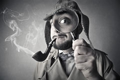 vintage investigator smoking a pipe and holding a magnifying glass